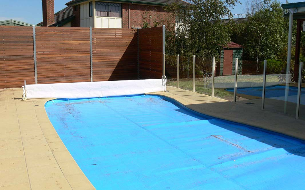 Pool Cover with Glass Fencing View