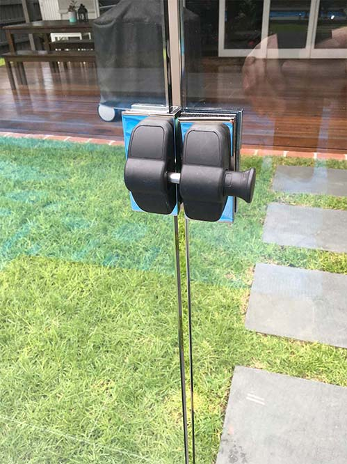glass pool fencing on grass